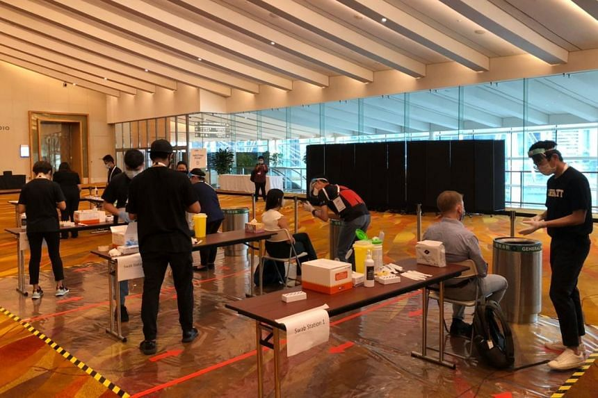 Participants getting tested for Covid-19 with Antigen Rapid Tests at the start of Singapore International Energy Week 2020.