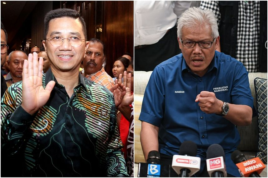 Several Pakatan Harapan leaders want Senior Minister for Economy Azmin Ali (left) and Home Minister Hamzah Zainuddin removed from the Cabinet.