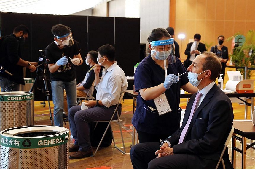 Participants being swabbed yesterday morning before attending conferences at the Singapore International Energy Week 2020. Around 215 tests were carried out yesterday, and most people appeared to have no issues with them. No one tested positive.