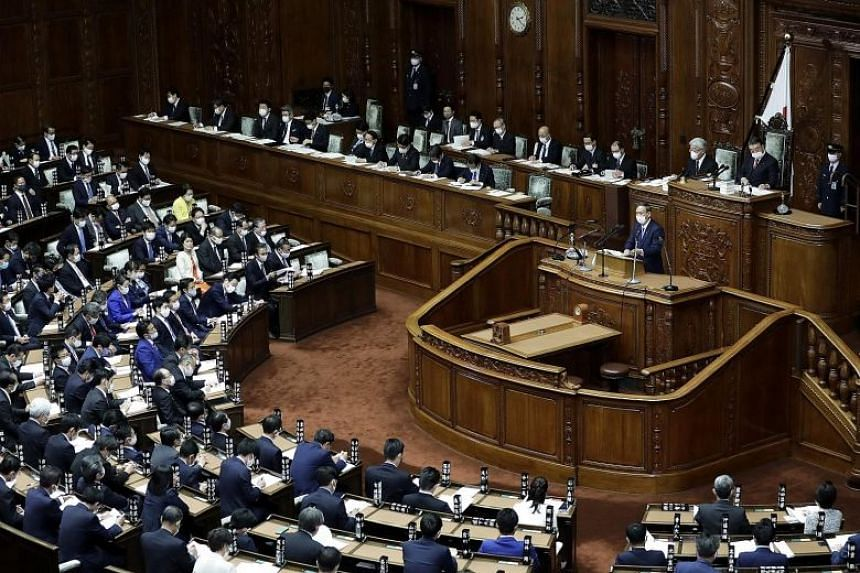 Japanese Prime Minister Yoshihide Suga making his debut policy speech in the Diet yesterday. Besides his environment pledges, he also discussed the need to revitalise a pandemic-hit economy.