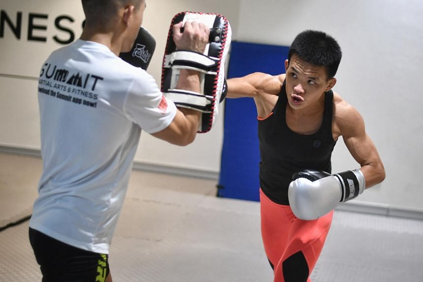 Mixed martial arts fighter Tiffany Teo (right) trains for her upcoming fight for the Chinese fighter's women's strawweight world title.