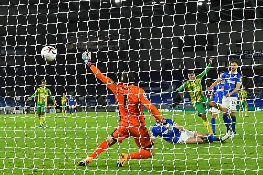 West Bromwich Albion's English striker Karlan Grant shoots to score their first goal on Oct 26, 2020.