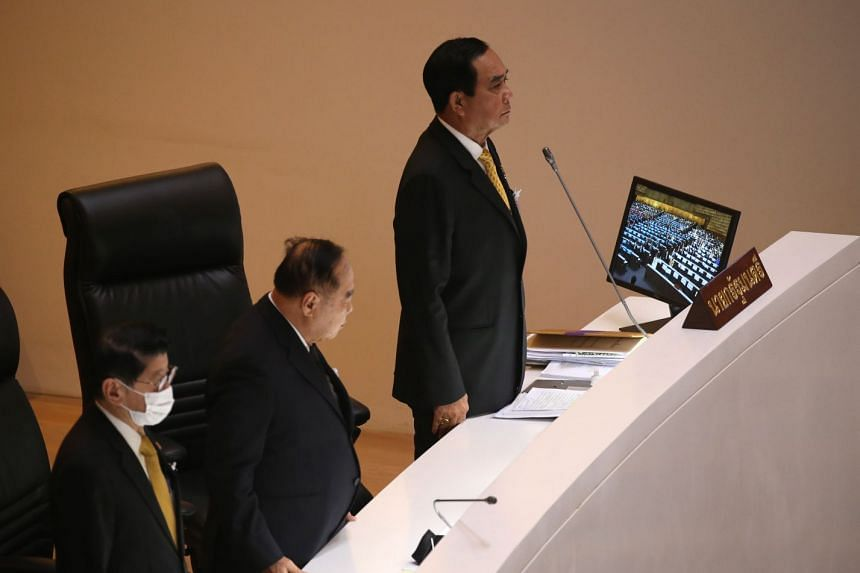 Prime Minister Prayut Chan-o-cha (right) and Deputy Prime Ministers Prawit Wongsuwan (centre) and Wissanu Krea-ngam attending a special session in the Thai Parliament yesterday to find a way out of the crisis.