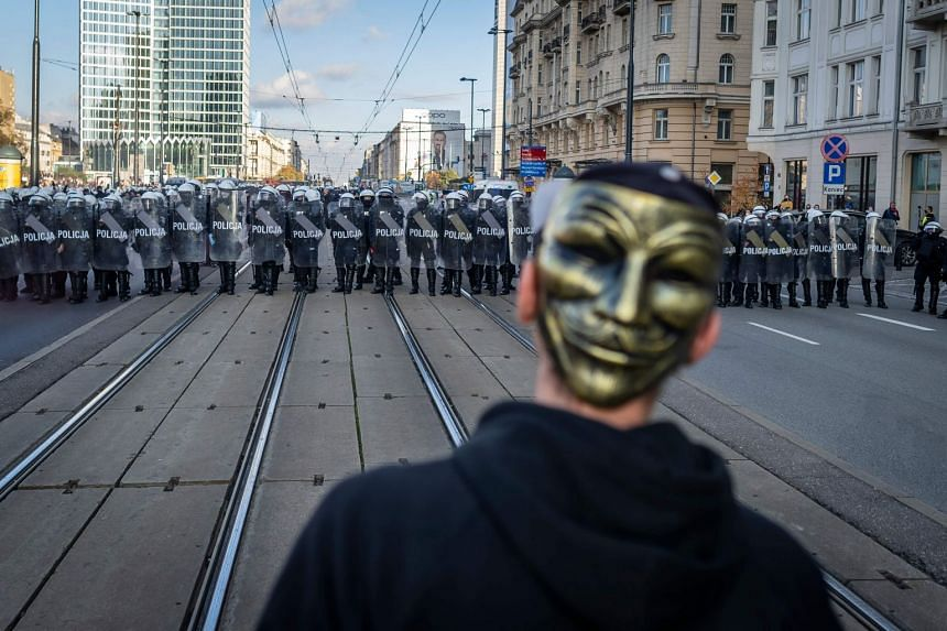 Police clash with participants of a demonstration against coronavirus restrictions on Oct 24, 2020 in Warsaw, Poland.