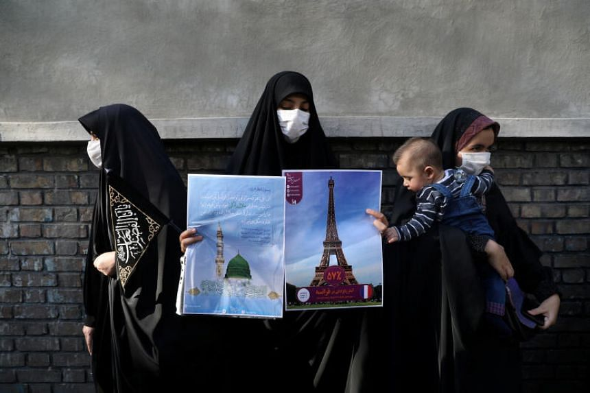 A woman takes part in a protest to condemn the French magazine Charlie Hebdo, in Teheran on Sept 9, 2020.