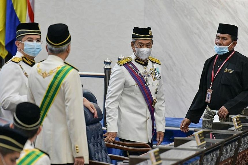 A May 18 file photo of Prime Minister Muhyiddin Yassin (centre) and Senior Minister for the Economy Azmin Ali (far left) in Parliament.