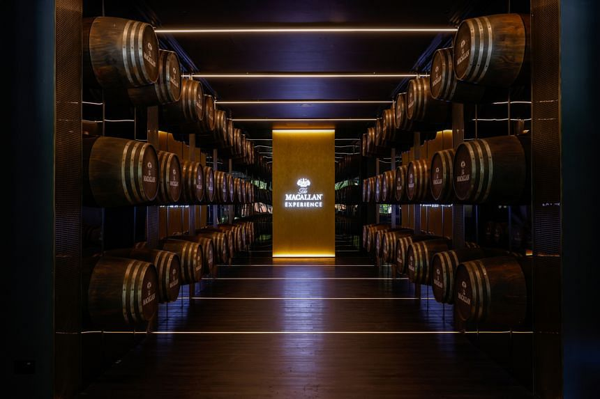 The experience starts with a walk down an Instagram-worthy tunnel lined with oak casks.