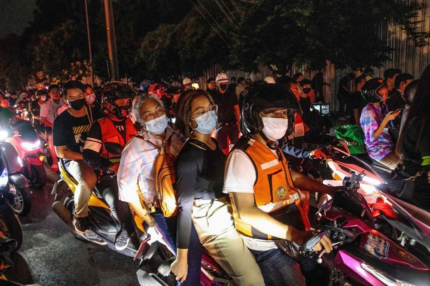 Congregating around demonstrations in their signature orange vests, the drivers are also helpful as look-outs.