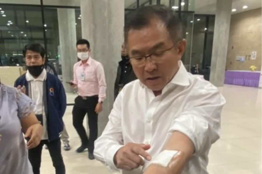 Thailand's Pheu Thai Party MP Visan Techatirawat cut his left hand and arm three times with a fruit knife.