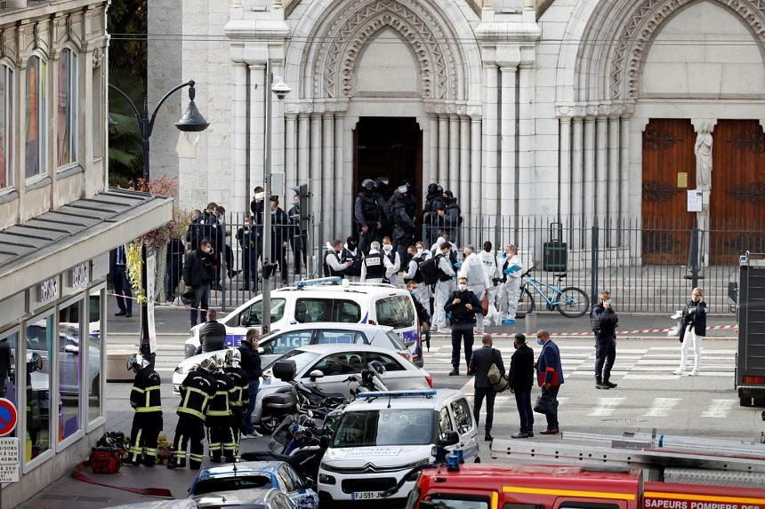 Security forces guard the area after a reported knife attack at Notre Dame church in Nice, France.