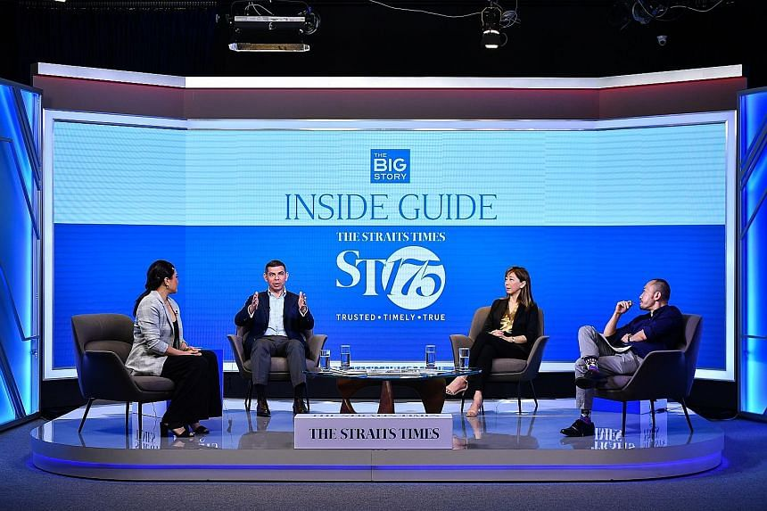 Straits Times editor Warren Fernandez (second from left) speaking yesterday at the trade launch of ST's revamped product, on a panel that included ST executive editor Sumiko Tan (third from left) and Singapore Press Holdings chief commercial officer