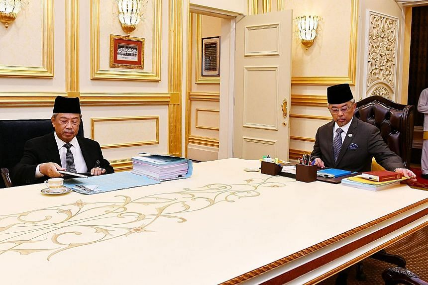 Malaysia's Prime Minister Muhyiddin Yassin (left) and the country's King, Sultan Abdullah Ahmad Shah, at their meeting at the National Palace in Kuala Lumpur yesterday. The Premier briefed the King on the crucial supply Bill that will be tabled in Pa