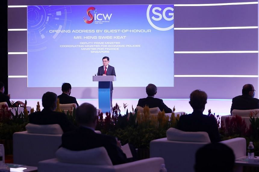 Singapore Deputy Prime Minister Heng Swee Keat announcing the launch of the Safer Cyberspace Masterplan in his keynote address at the opening of SICW 2020. PHOTO: SINGAPORE INTERNATIONAL CYBER WEEK