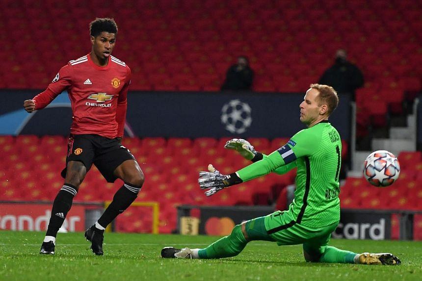Manchester United striker Marcus Rashford scores his team's second goal against Leipzig.