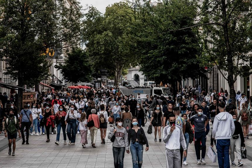 People walk in the centre of Lyon in August 2020.