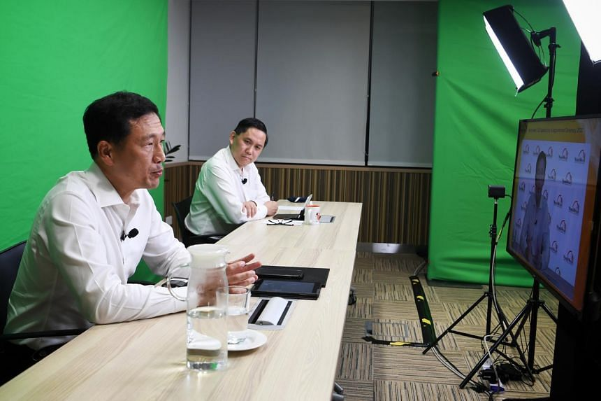 Transport Minister Ong Ye Kung (left) and North West district mayor Alex Yam during the North West CDC Appreciation and Appointment Ceremony.