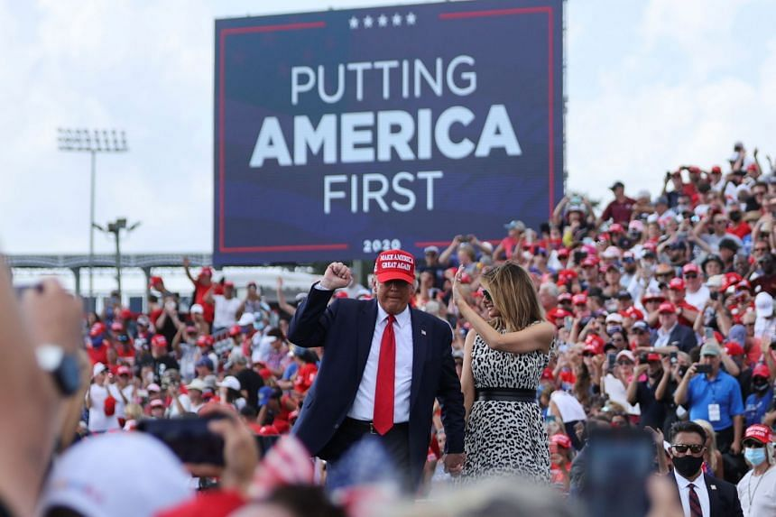 US President Donald Trump and first lady Melania at a campaign rally in Tampa, Florida, on Oct 29, 2020.