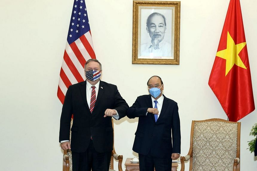 US Secretary of State Mike Pompeo bumps elbows with Vietnam's Prime Minister Nguyen Xuan Phuc at the Government Office in Hanoi, on Oct 30, 2020.