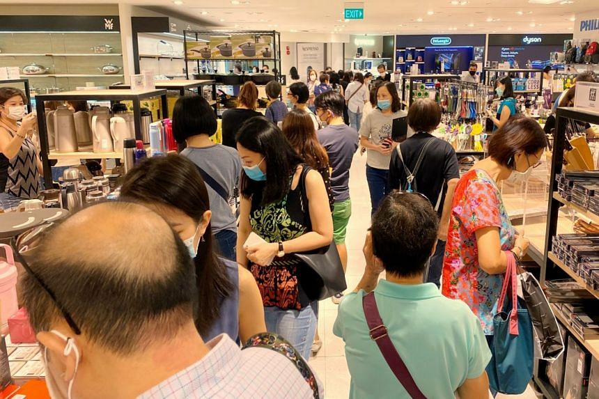 Shoppers look for bargains at Robinsons at Raffles City on Oct 30, 2020.