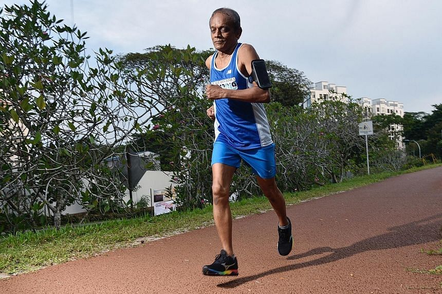 Chandrasekaran near the Old Bukit Timah Railway Station yesterday, when he completed the 175km ST Virtual Run distance. He covered the distance over 16 sessions. ST PHOTO: DESMOND WEE