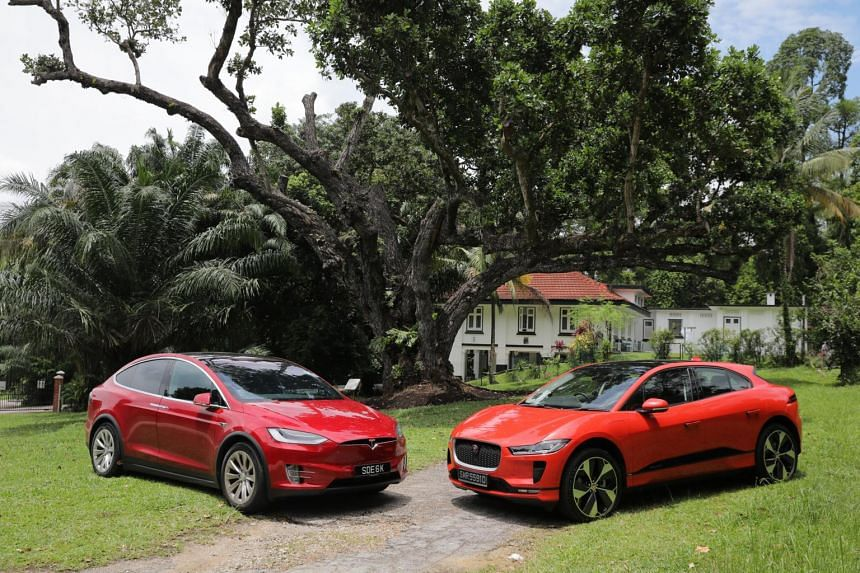 The Tesla's looks (left) are less head-turning than those of the  Jaguar I-Pace (right).