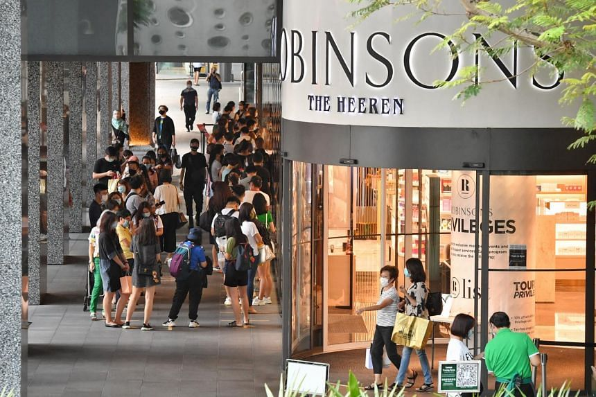 Shoppers queueing to enter the Robinsons store at The Heeren on Oct 30, 2020.
