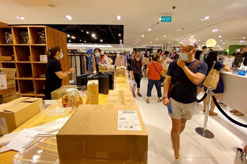 Shoppers at the Robinsons store in Raffles City on Oct 30, 2020.