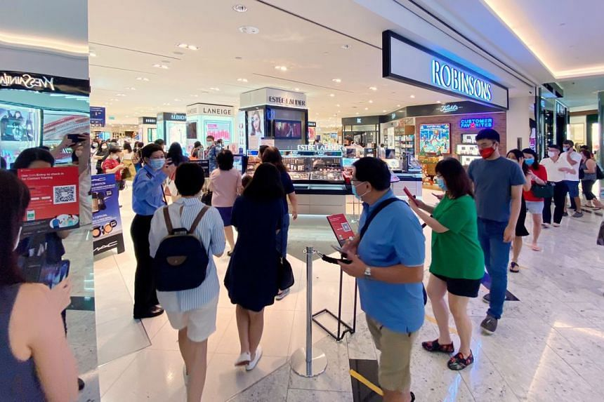 Shoppers at the Robinsons store at Raffles City on Oct 30, 2020.
