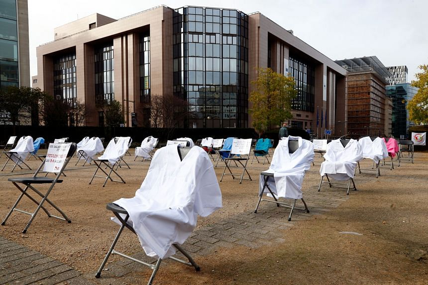 A protest site in Brussels with nurses' clothing draped over chairs in a symbolic action by the European Federation of Public Service Unions - which represents health and social service workers - to demand healthcare funding. PHOTO: REUTERS