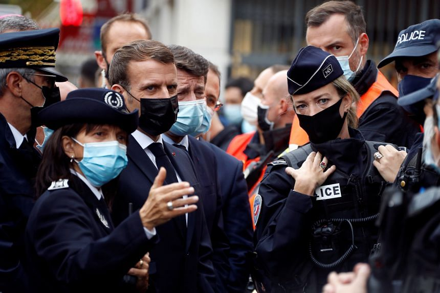 French President Emmanuel Macron (second from left) visits the scene of a reported knife attack at Notre Dame church in Nice, France, on Oct 29, 2020.