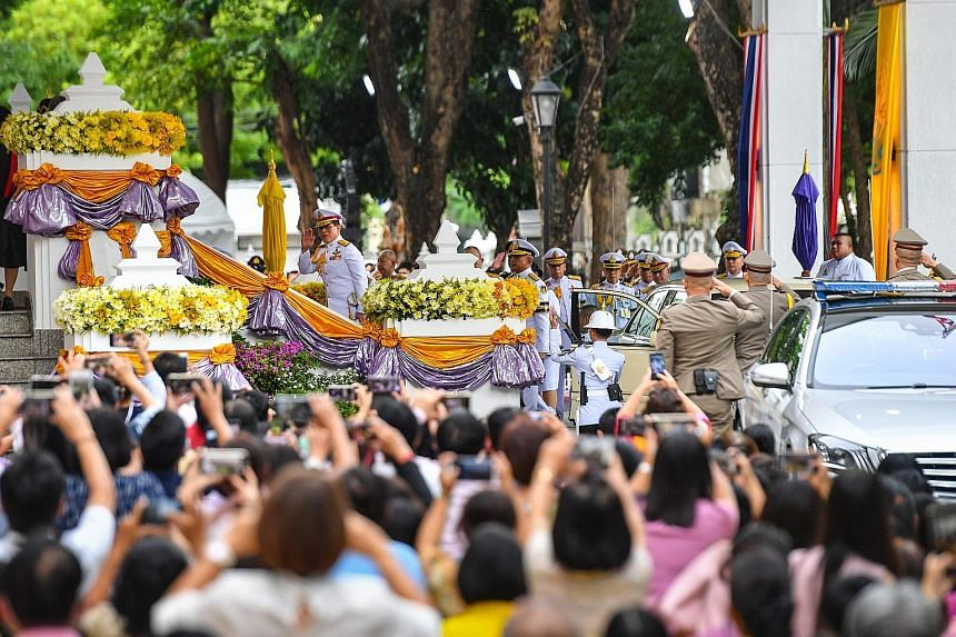 People taking photos as Thailand's King Maha Vajiralongkorn arrived to preside over a graduation ceremony at Thammasat University in Bangkok yesterday.