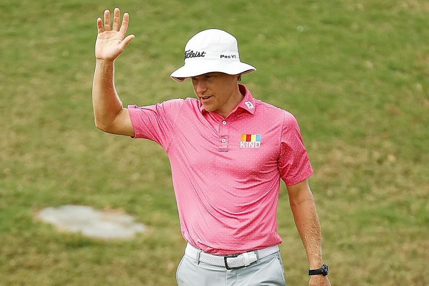 American Peter Malnati acknowledging spectators' applause after his birdie on the 18th green during the first round of the Bermuda Championship at Port Royal Golf Course on Thursday.
