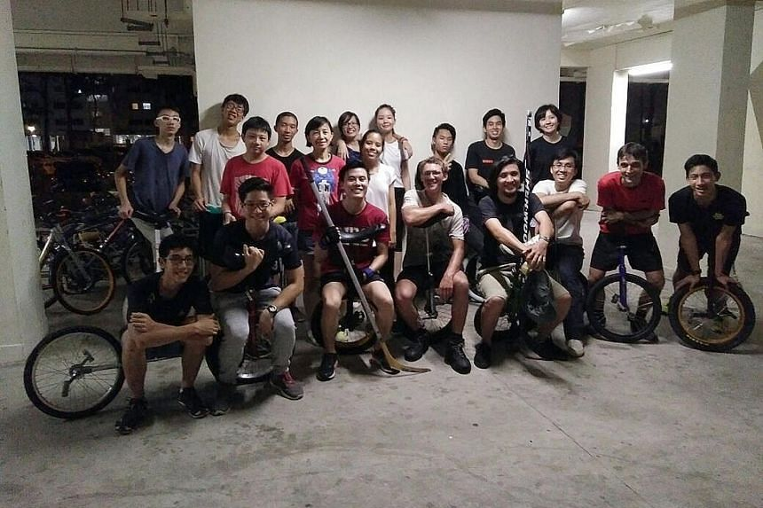 Cai Jiahui (top row, far right) and Singapore Unicyclists members meeting Ed Pratt (bottom row, fourth from left) in 2017 when the Briton stopped over while on a round-the-world trip on a unicycle. Sarah Ang, 18, and Seth Tan, 26, are members of Sing