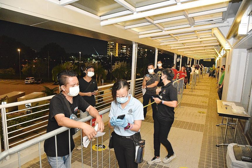 Some 250 spectators were seated apart at One Championship's Inside The Matrix event at the Singapore Indoor Stadium yesterday. The event is part of a pilot project that the Government hopes can pave the way for larger-scale ones to resume safely. Fan
