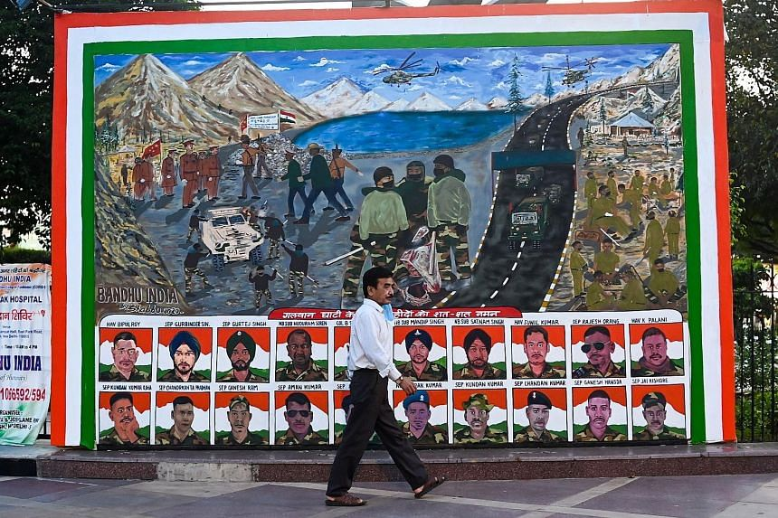 A poster in New Delhi depicting portraits of Indian soldiers killed during a border clash with Chinese troops in June. PHOTO: AGENCE FRANCE-PRESSE