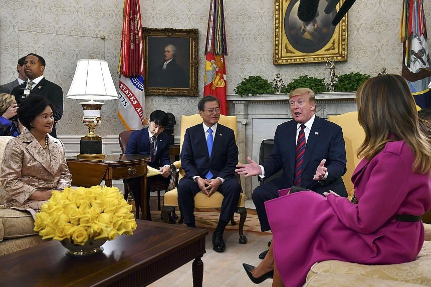 US President Donald Trump and South Korean President Moon Jae-in with their wives at the White House in April last year. PHOTO: AGENCE FRANCE-PRESSE