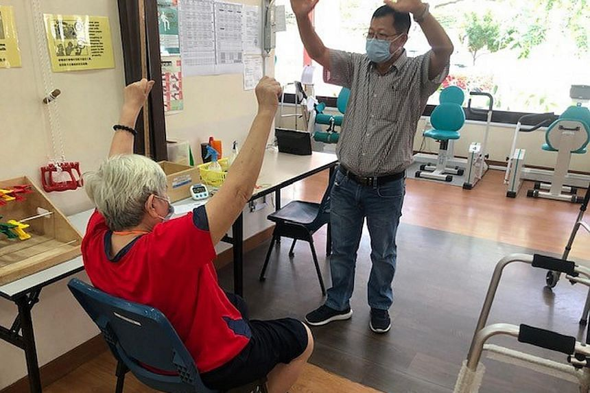 To overcome manpower constraints amid Covid-19, The Salvation Army Peacehaven Nursing Home employed staff from SG Healthcare Corps, such as this senior care associate (above). A client at social service agency Awwa being reassessed by a staff member