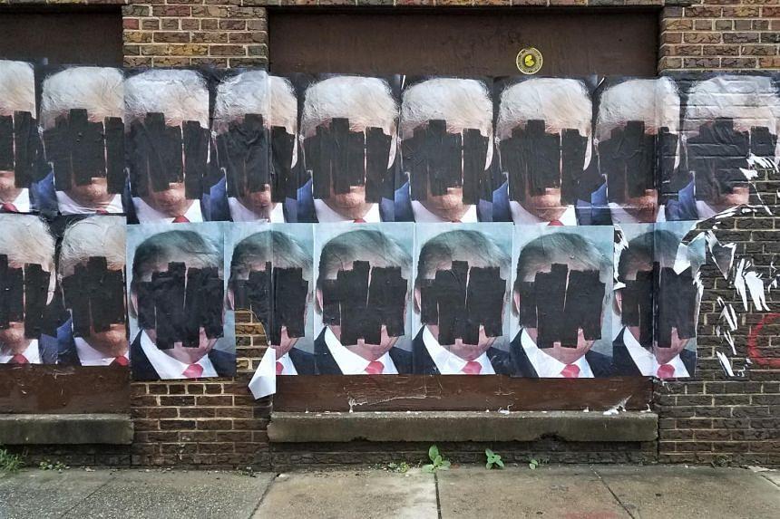 Anti Trump posters on a Washington DC street.