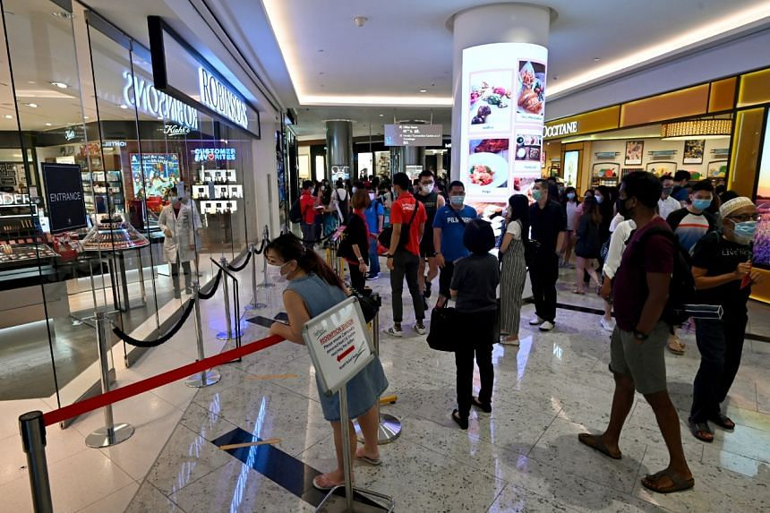 Shoppers outside the temporarily closed Robinsons store at Raffles City on Oct 31, 2020.