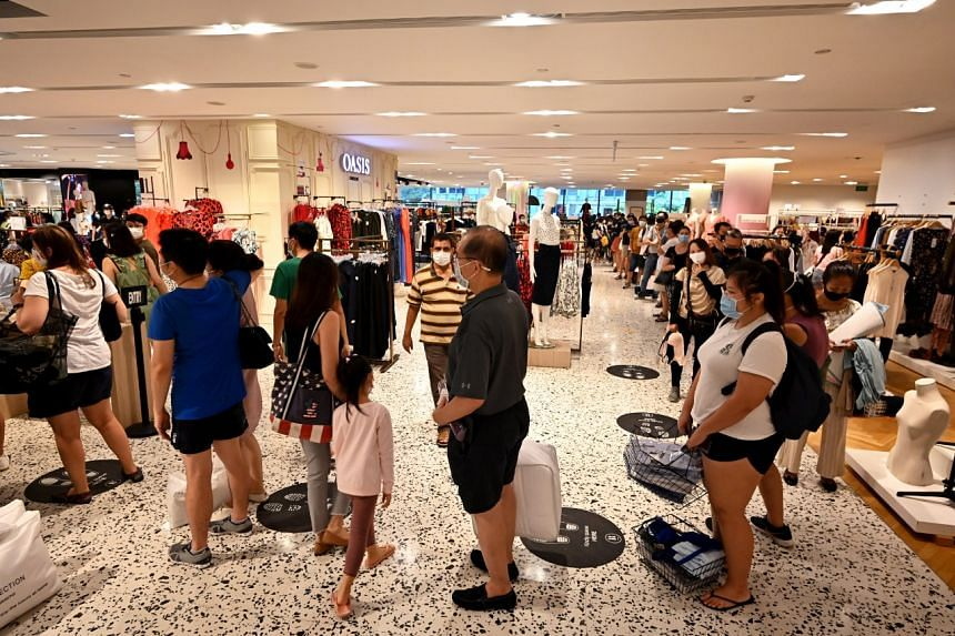 Shoppers queueing to make payments at Robinsons' Heeren outlet on Oct 31, 2020.