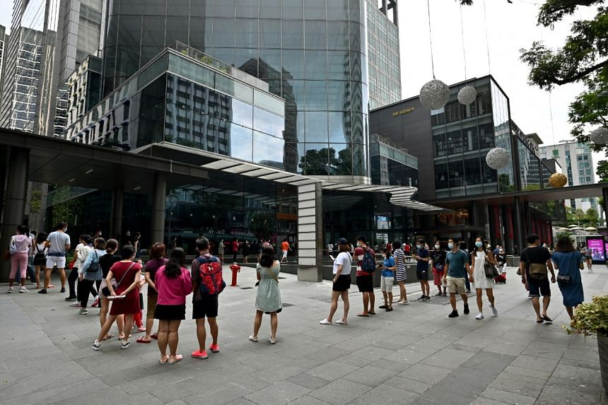 Shoppers queueing outside the Robinsons store at The Heeren on Oct 31, 2020.