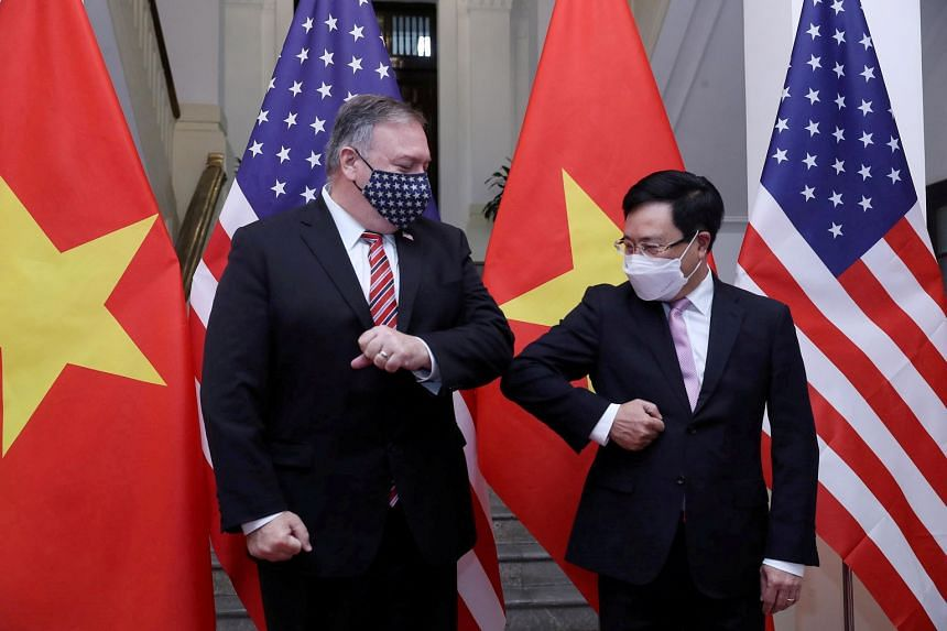 US Secretary of State Mike Pompeo and Vietnam's Deputy Prime Minister and Foreign Minister Pham Binh Minh in Hanoi yesterday. While ties between the two countries, once bitter enemies, have improved significantly over the years, some trade tensions h