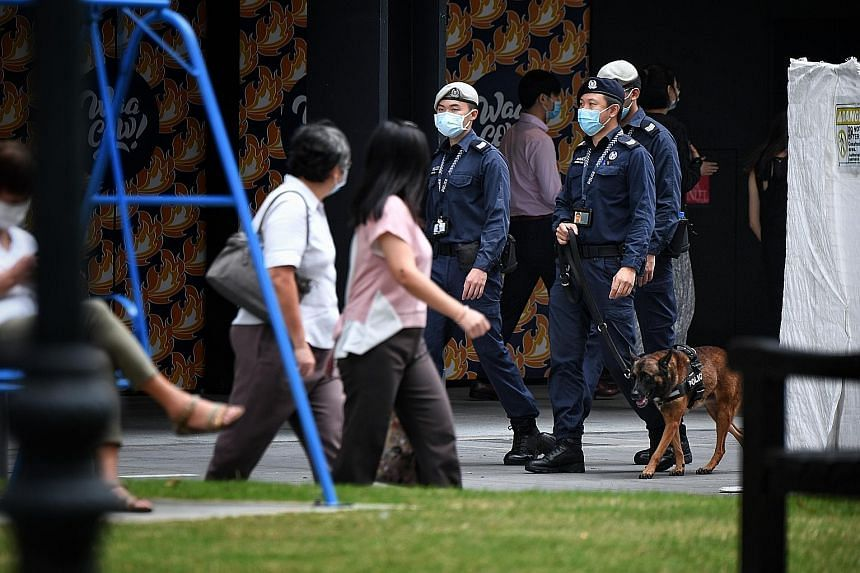 Public Transport Security Command officers and a Singapore Police Force K-9 Unit officer patrolling at Raffles Place MRT station in September. Singapore tied with Turkmenistan for the top spot in the Gallup 2020 Global Law and Order Report, with both