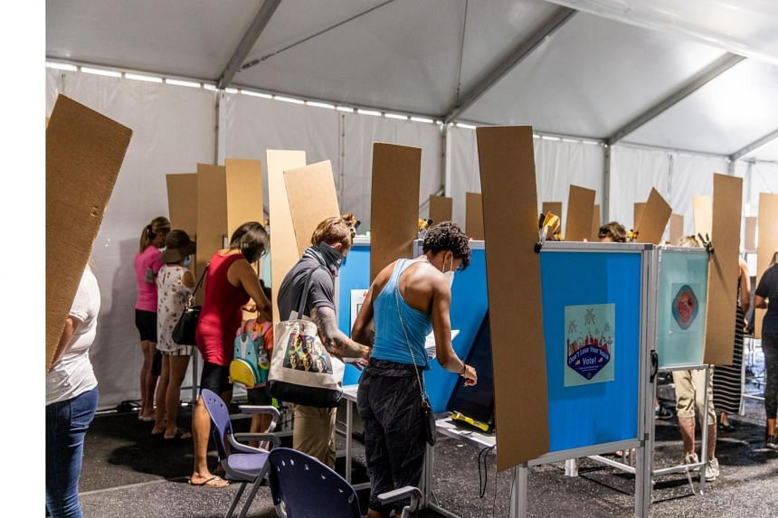 Las Vegas residents casting early votes for the presidential election in Nevada, US, on Oct 17, 2020.