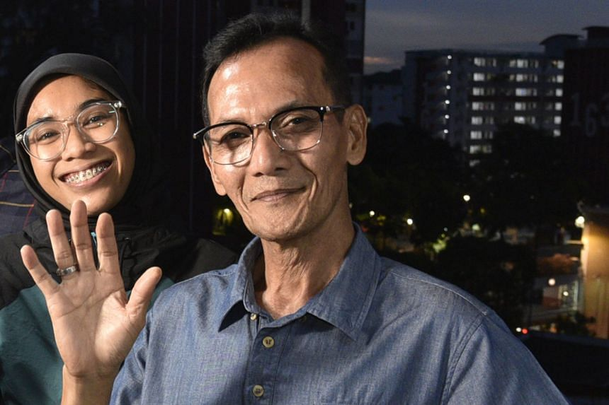 (From left) Ms Zulastri Zulkifli and her father Mr Zulkifli Atnawi.
