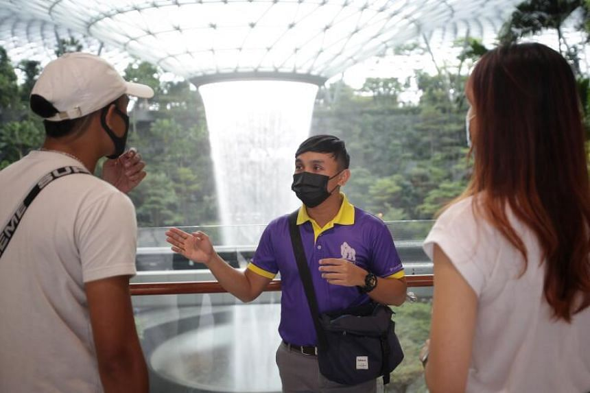 A Monster Day Tours guide giving a private tour at Jewel Changi Airport on Oct 14, 2020.