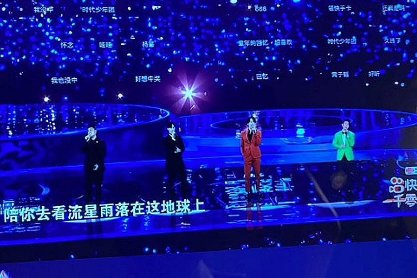 The purported F4 reunion on China's Jiangsu Television last Friday turned out to be fake as only Van Ness Wu (above, extreme right) was present on stage.