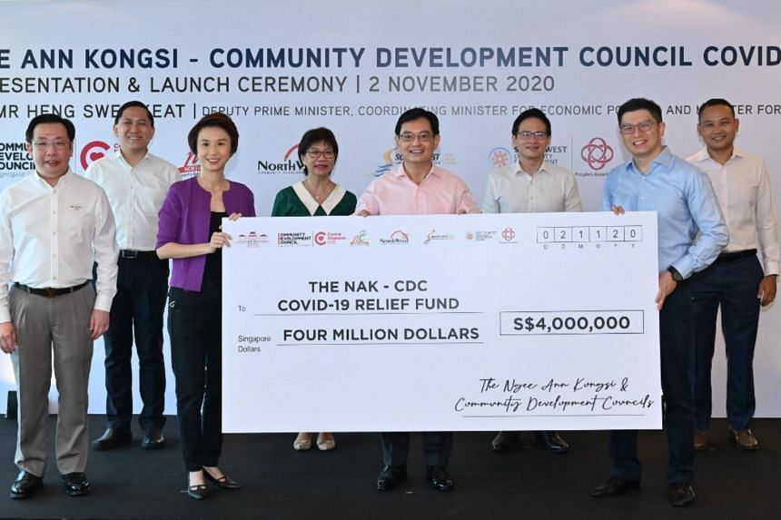 (From left) Honorary treasurer of Ngee Ann Kongsi James Teo, North West district mayor Alex Yam, South West district mayor Low Yen Ling, Central Singapore district mayor Denise Phua, Deputy Prime Minister Heng Sweet Keat, North East district mayor De