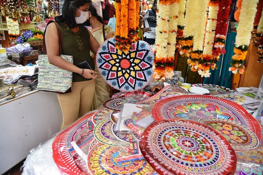 A shopper in Campbell Lane looking at festive floor decorations on Nov 1, 2020.