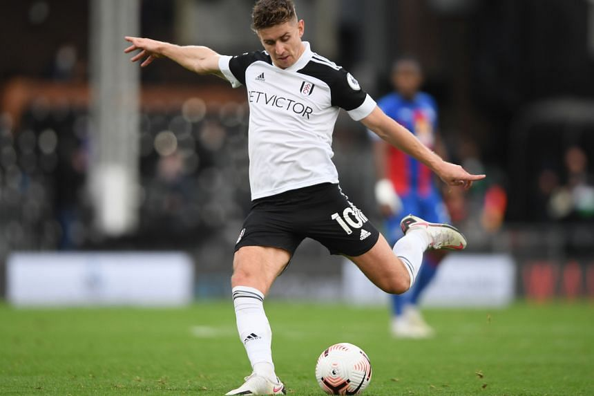 Fulham's Tom Cairney scores their first goal during the Fulham v Crystal Palace match on Oct 24, 2020.